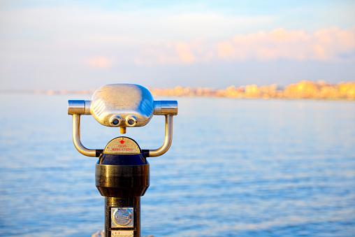 Coin operated binoculars on the Viareggio pier at sunset