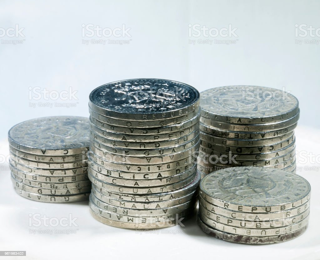 coin stack on background. Quetzal, Guatemala. 25 cents, central america. stock photo