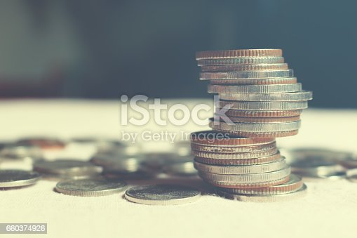 864278180istockphoto Coin stack on table office with finance saving concept. 660374926