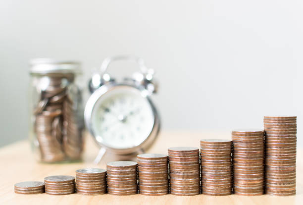 Coin stack step growing up to success financial business with clock and jar, Save money and investment concept, Copy space for your text stock photo
