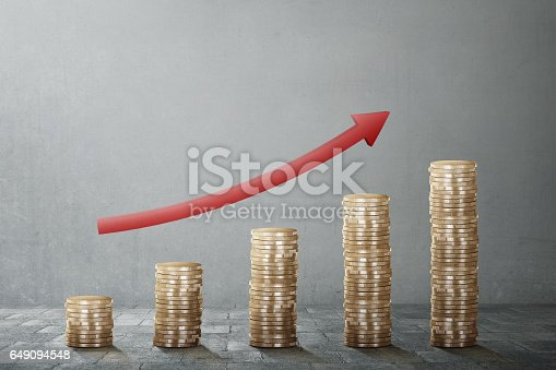 istock Coin stack with red arrow chart rise 649094548