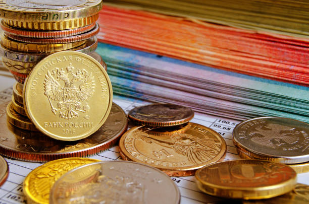 coin the russian ruble, other coins and bundles of money on the financial report. - rates stock photos and pictures