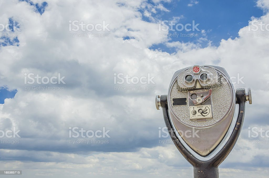 Coin-operated Binoculars against the Sky stock photo
