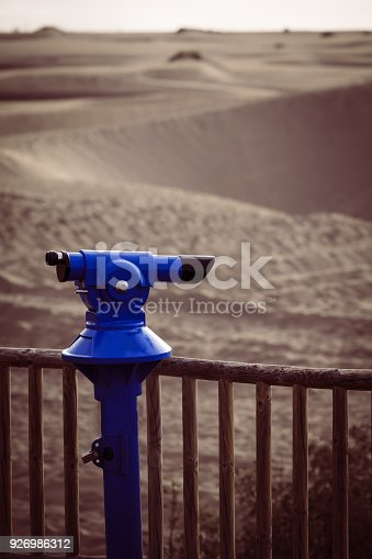 fecc4842 istock Coin-operated binoculars looking out over a seashore landscape  926986312 >>