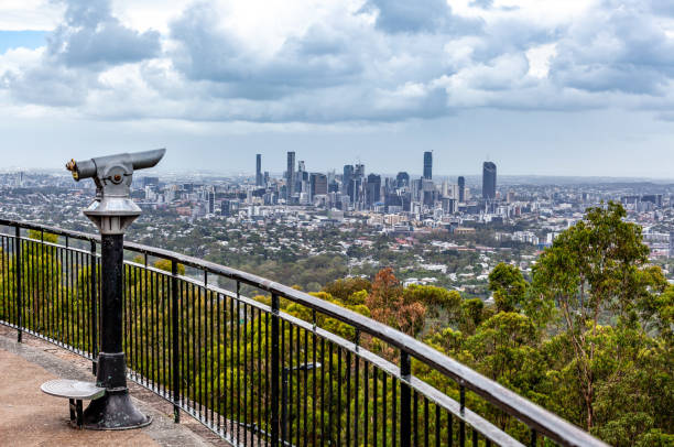 Coin-operated binoculars pointed at Brisbane CBD skyline from lookout Coin-operated binoculars pointed at Brisbane CBD skyline from lookout coot stock pictures, royalty-free photos & images