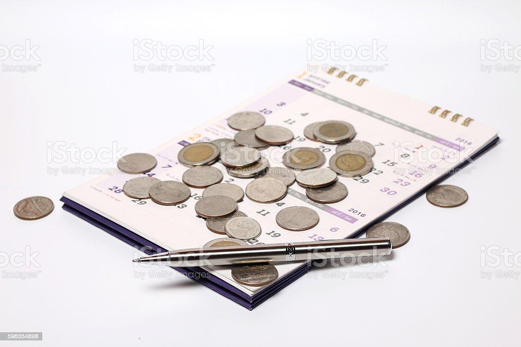 coin,pen,and calendar royalty-free stock photo
