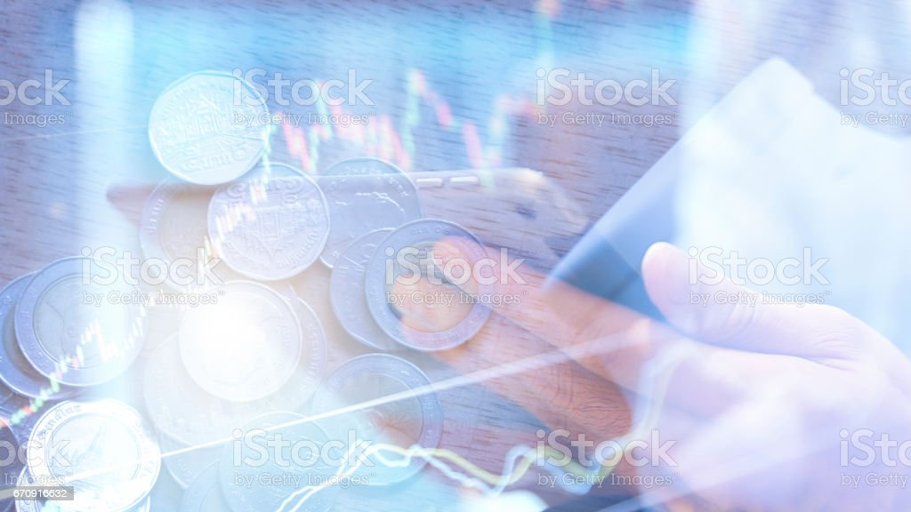 coins and account book in finance and banking concept stock photo