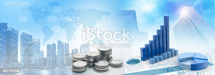istock coins and charts in cityscape blue background 932162698