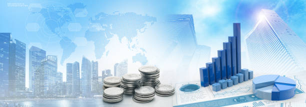 coins and charts in cityscape blue background stock photo