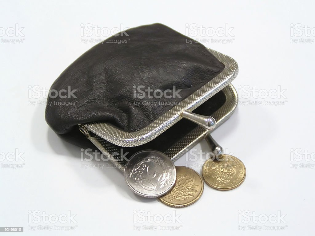 Coins and old purse royalty-free stock photo