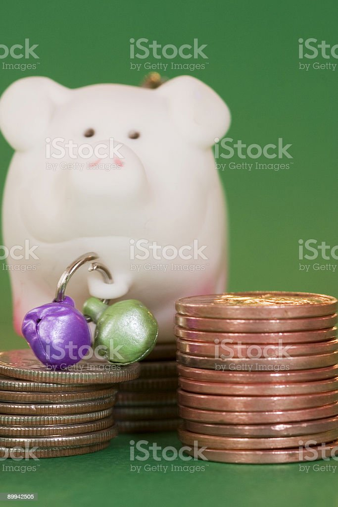 coins and pig stock photo