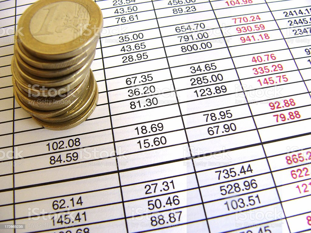 Coins and spreadsheet royalty-free stock photo