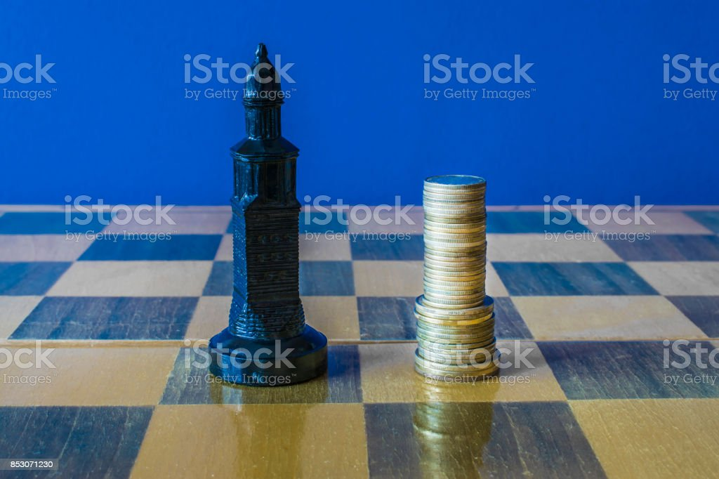 Coins Are Formed Like A King On A Chessboard Stock Photo