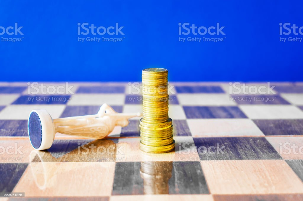 Coins Are Formed Like A King On A Chessboard Stock Photo More