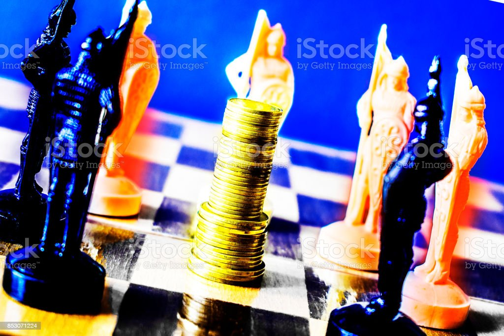 Coins Are Stacked On A Chessboard Surrounded By Black And White