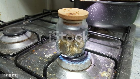 657417590 istock photo coins cooked on the stove 1191289792