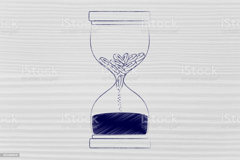 coins disappearing into sand into an hourglass stock photo