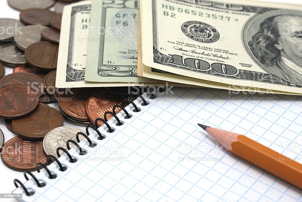 Coins, dollar bills, notebook and pencil. royalty-free stock photo