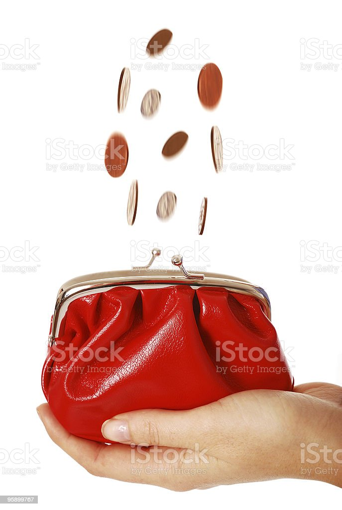Coins falling into purse royalty-free stock photo