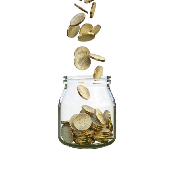 monedas llenan un tarro de cristal - foto de stock