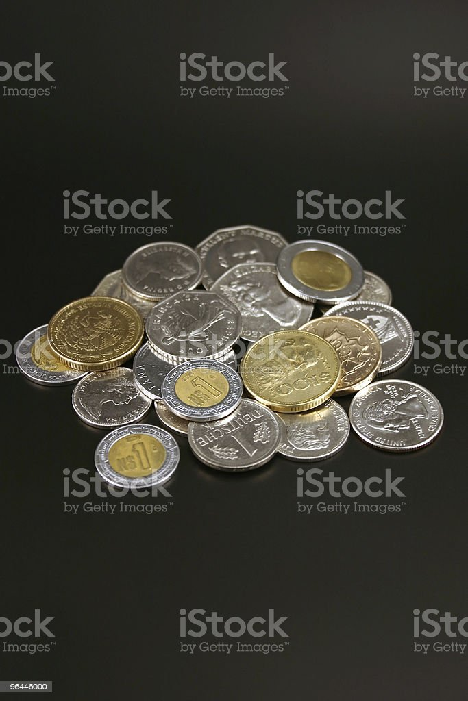 Coins from around the world royalty-free stock photo
