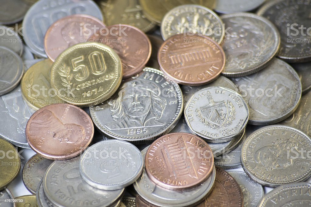 Coins from many countries, mostly south american ones. royalty-free stock photo
