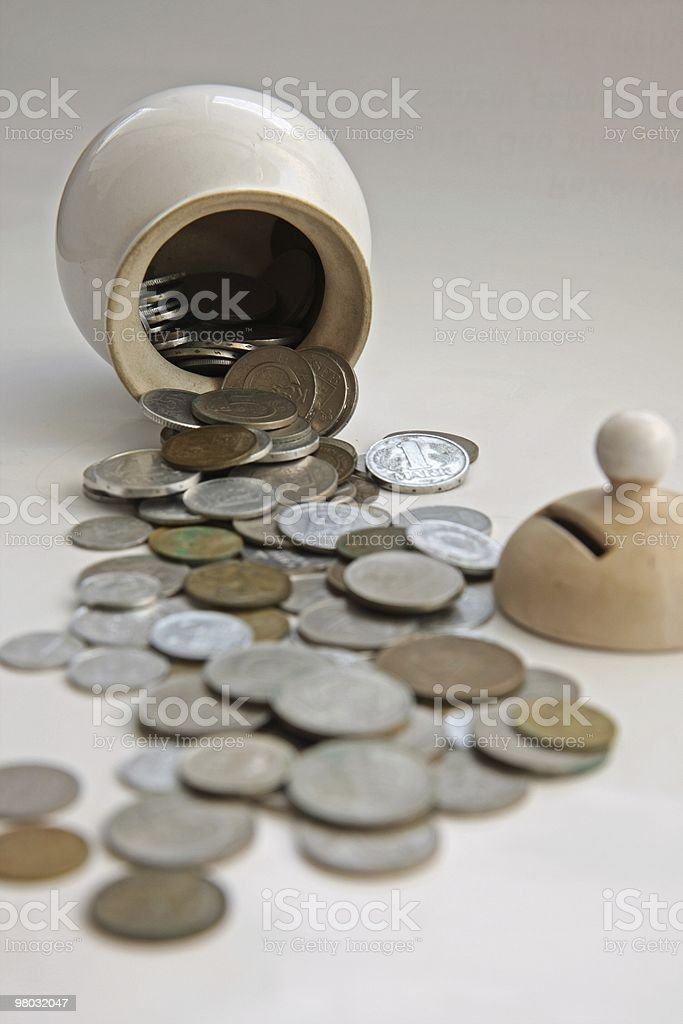 Monete da moneybox foto stock royalty-free
