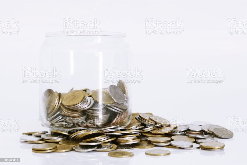 Coins in a glass bottle royalty-free stock photo