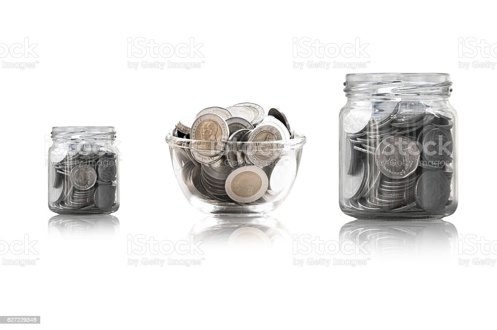 coins in a glass jar against stock photo