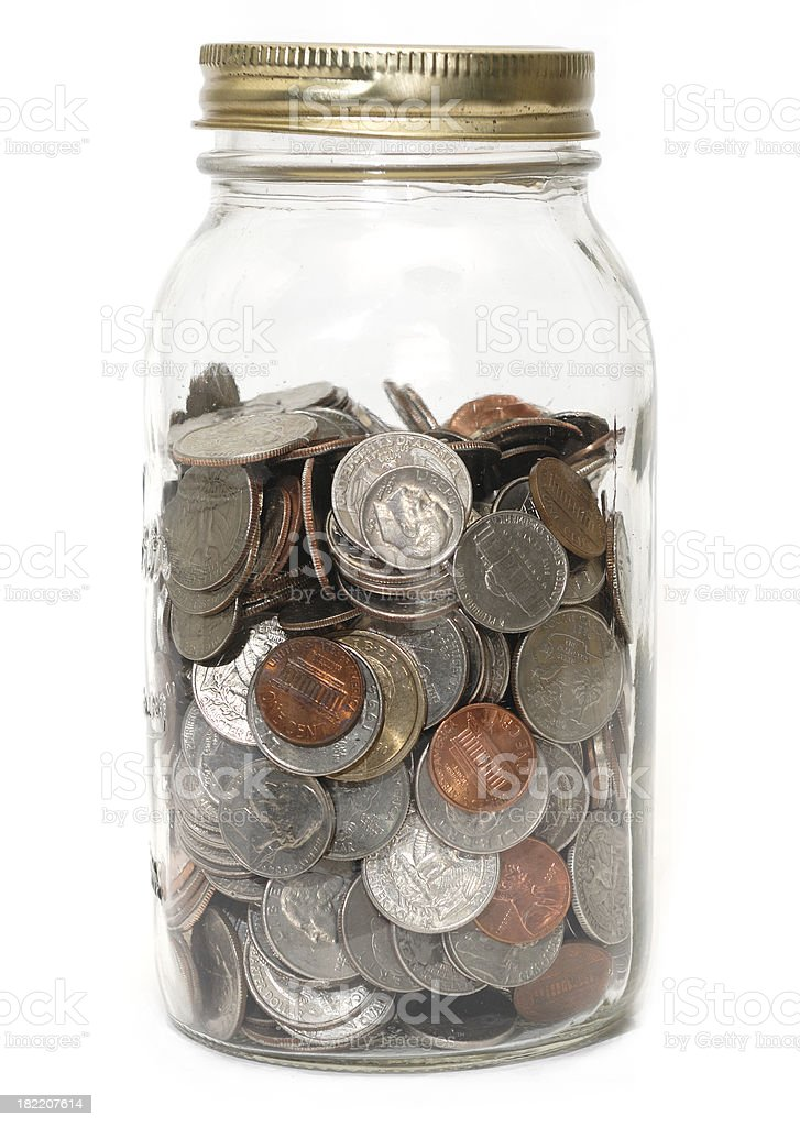 Coins in a jar royalty-free stock photo