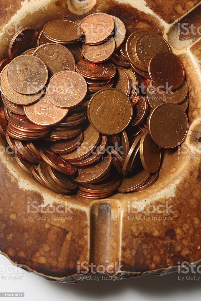 Coins in ashtray stock photo