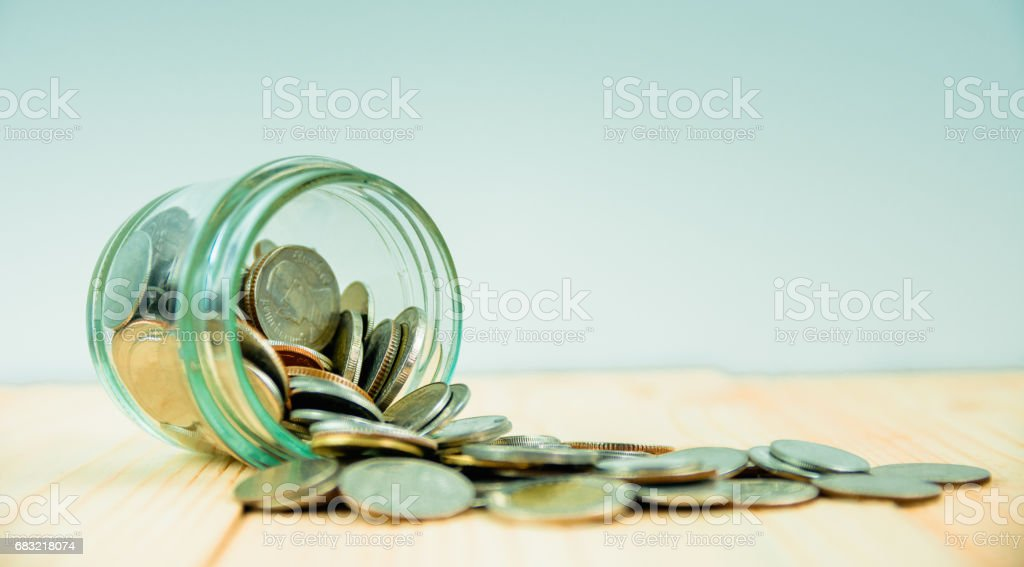 Coins in glass jar for money saving financial concept 免版稅 stock photo