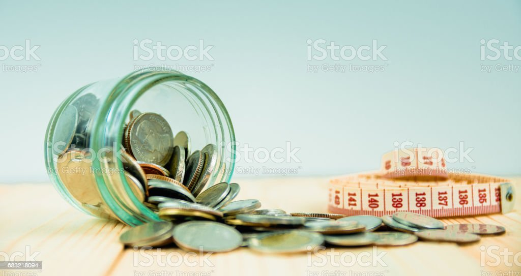 Coins in glass jar for money saving financial concept ロイヤリティフリーストックフォト