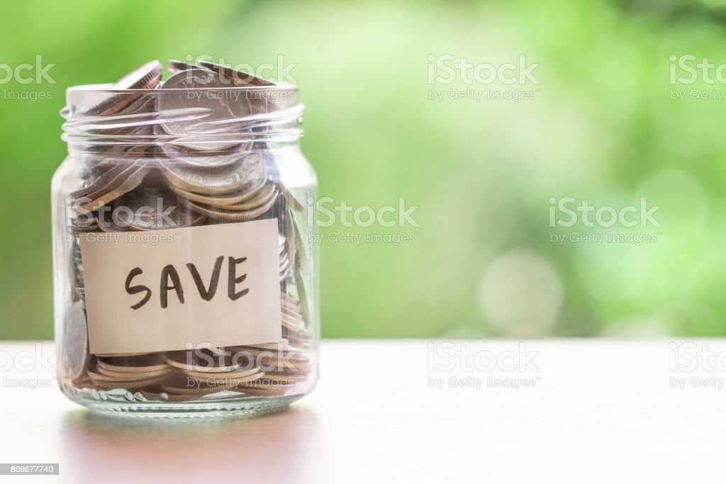Coins in glass jar for money saving financial concept stock photo