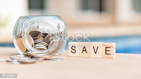 istock Coins in glass jar for money saving financial concept 904589622