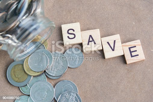 istock Coins in glass jar for money saving financial concept 904589750