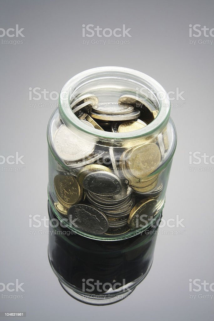 Coins in Glass Jar royalty-free stock photo