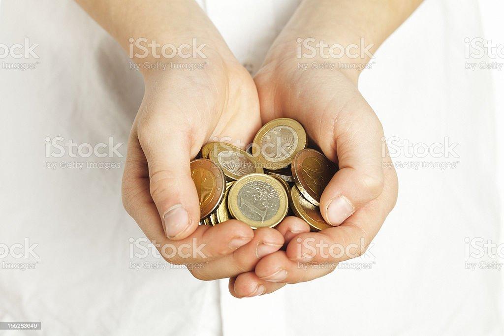 Münzen in hand. – Foto