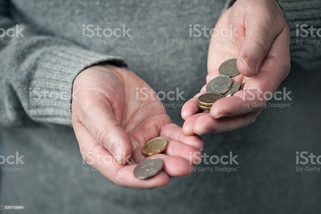 coins in hands closeup (Russian rubles) stock photo