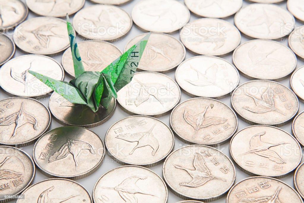 Coins in korean finance with Crane bird stock photo