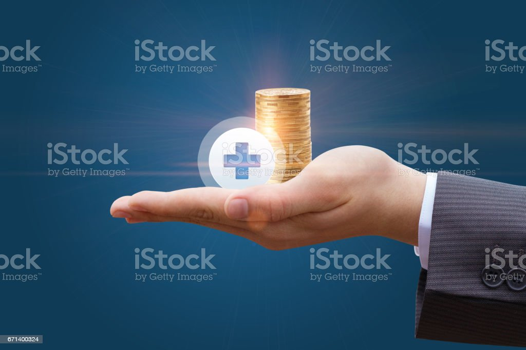 Coins in the hand of a businessman . stock photo