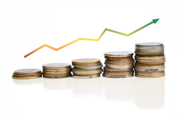 Coins increasing value chart with arrow. Company growth image. Colorful. Yellow. Shaded. White background. stock photo