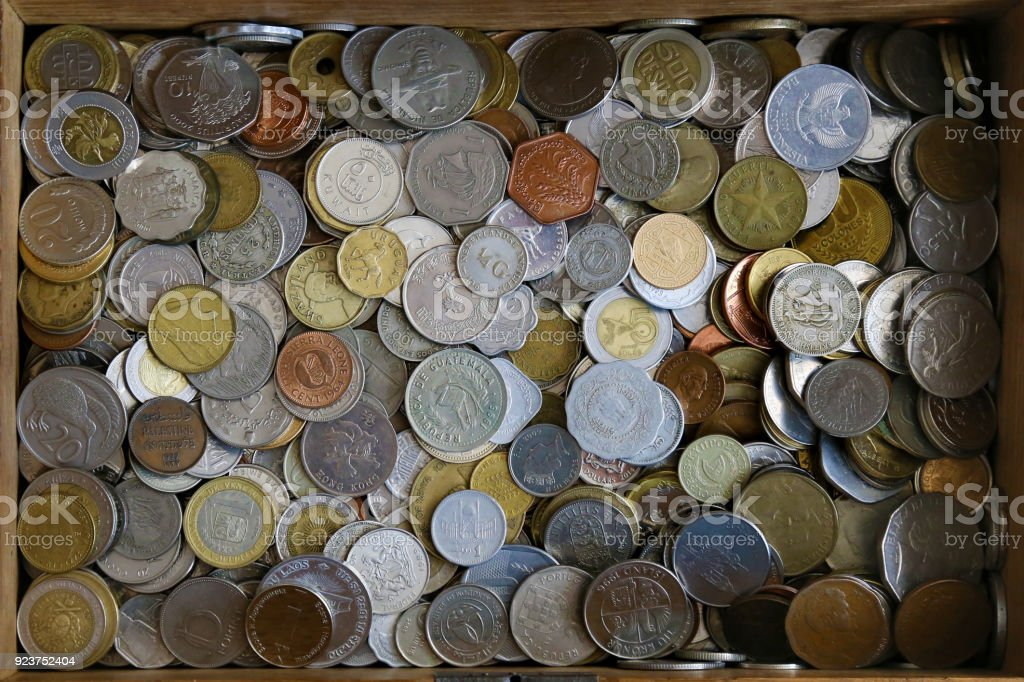 Coins mixed collection, gathered in a wooden box. stock photo