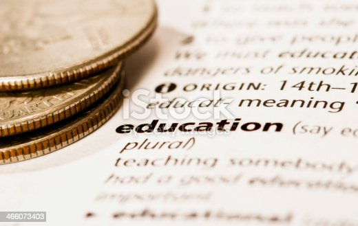 coins next to word education in document learning is expensive stock