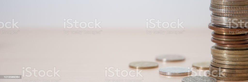 Coins of different countries and different advantages and colors on the table. stock photo
