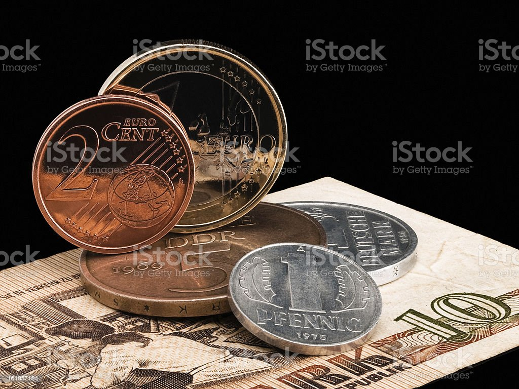 Coins of GDR (DDR) and the European Union. stock photo