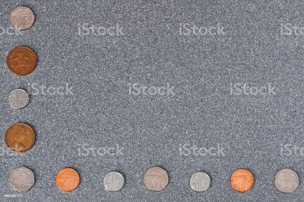 Coins of Great Britain of different dignity against the background of gray granite. royalty-free stock photo