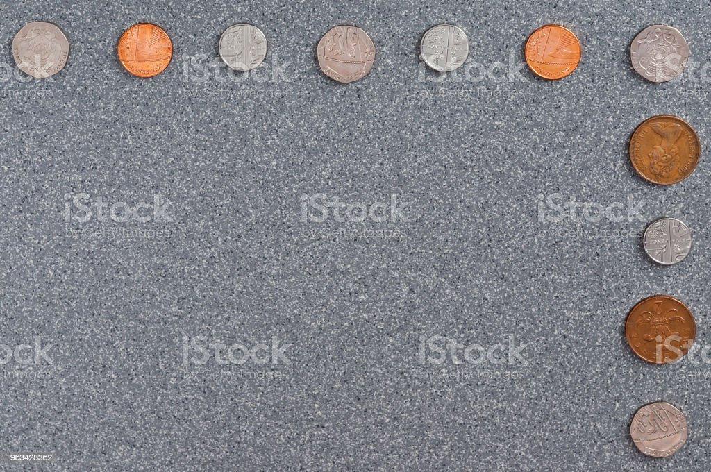 Coins of Great Britain of the background of gray granite. - Zbiór zdjęć royalty-free (Bankowość)