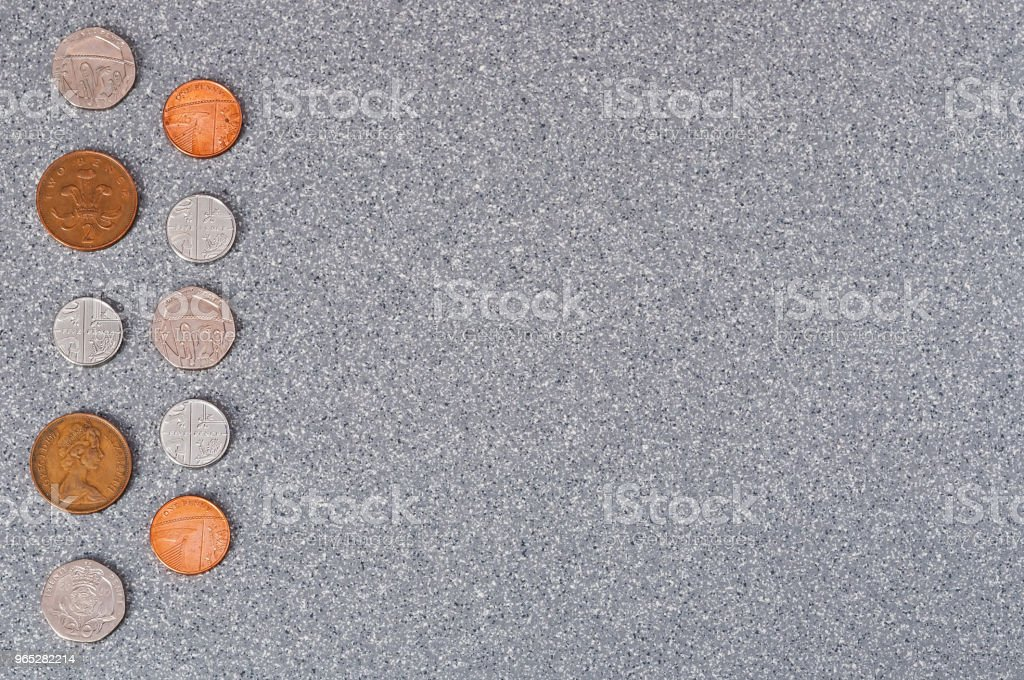 Coins of Great Britain on a background of gray granite. - Zbiór zdjęć royalty-free (Bangkok)