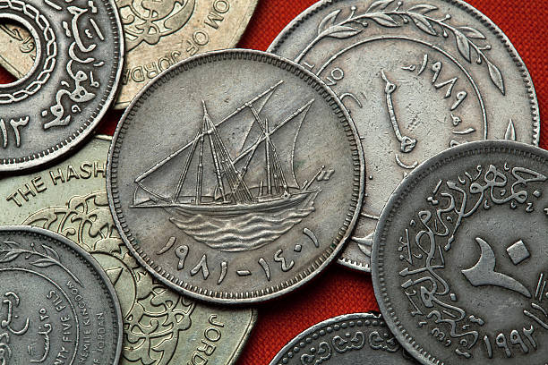 coins of kuwait. kuwaiti sailing vessel - kuwait currency stock photos and pictures